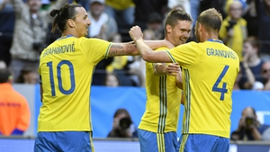 Mikael Lustig of Sweden celebrates with Zlatan Ibrahimovic and Andreas Granqvist