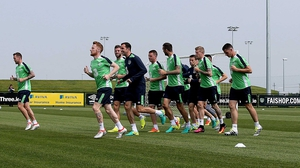 The squad warms up for the session ahead of their departure to their Euro 2016 training base in Versailles