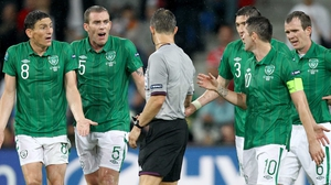 Ireland's players surround the referee during the loss to Croatia