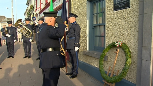 A wreath was laid beneath a plaque to Det Gda McCabe's memory outside Adare Garda Station