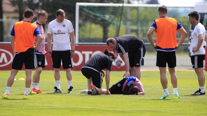 Kyle Lafferty receives medical attention after appearing to suffer a groin injury