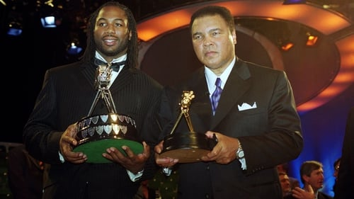 Lennox Lewis (L) and Muhammad Ali pose for the cameras at the BBC Sports Personality of the Year Awards ceremony in 1999