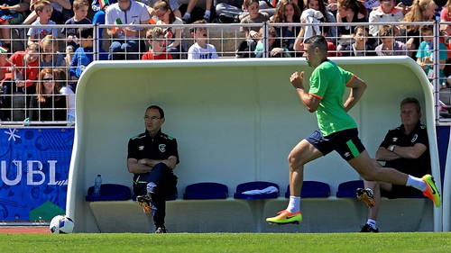 Jonathan Walters going through his paces as the manager watches on