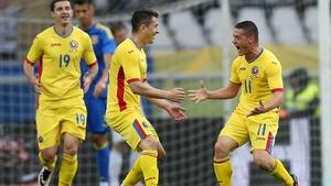 Romania's Gabriel Torje celebrates with Andrei Prepelita after scoring against Ukraine