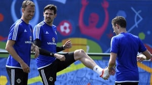 Kyle Lafferty (C) and defender Jonny Evans (L) at Northern Ireland training today