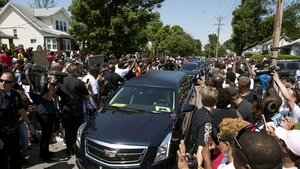 Muhammad Ali's hearse makes its way through the streets of Louisville