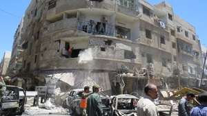 At least 20 people were killed and scores wounded in twin suicide and car bomb blasts in a Damascus suburb yesterday