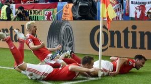 Aaron Ramsey, Chris Gunter and Hal Robson-Kanu celebrate the latter's winning goal