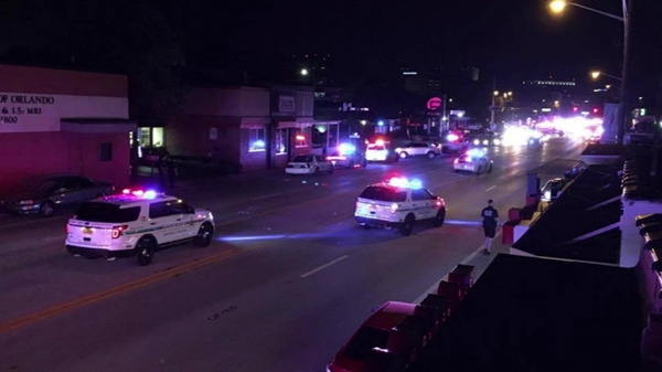 Police and emergency services at the scene of the shooting early this morning