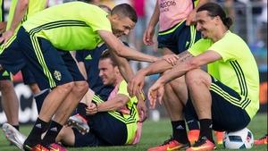 Zlatan Ibrahimovic (R) and forward Marcus Berg share a joke during training