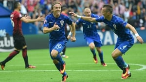Luka Modric wheels away in delight after his winner