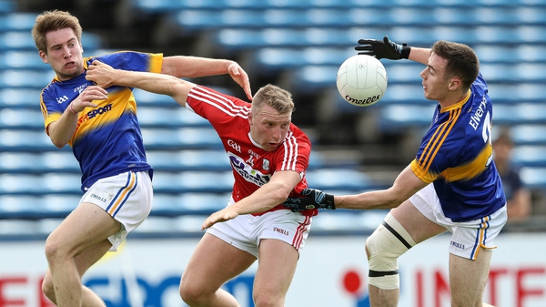 Tipperary duo Bill Maher and Alan Campbell battle Brian Hurley of Cork