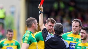 Neil McGee was sent off just before half-time