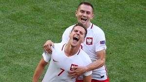 Milik celebrates with Artur Jedrzejczyk