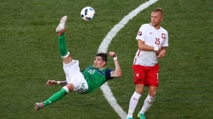 Kyle Lafferty acrobatically tried to get Northern Ireland back in the game