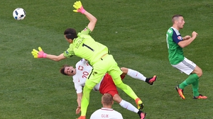 Polish keeper Wojiech Szczesny takes out team-mate Lukasz Piszczek during a rare moment of uncertainty