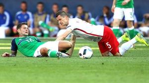 Oliver Norwoo battles with Poland's Krzysztof Maczynski