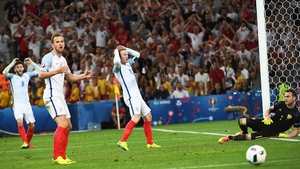 Harry Kane reacts to a missed chance against Russia