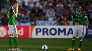 Kyle Lafferty (L) and Steven Davis look dejected during Northern Ireland's loss to Poland