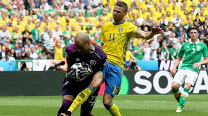 Ireland keeper Darren Randolph is challenged by Sweden's Marcus Berg