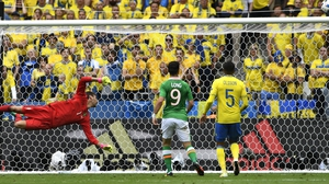 Ireland striker Shane Long watches on as a chance on the Swedish goal slips just wide