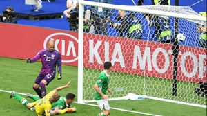 Clark watches on helpless as his wayward header hits the back of the Ireland net on Monday