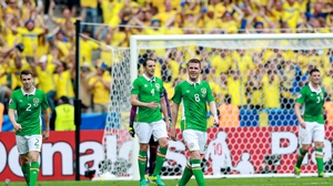 Ireland players show their dejection after Sweden leveled