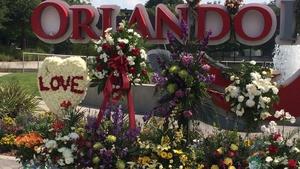 Flowers are left near the Pulse nightclub in Orlando