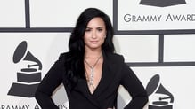 Demi Lovato looks chuffed with her bodychain - papped at the 58th Grammy Awards in February 2016
