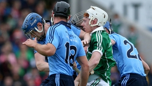 Lynch finds himself under pressure from three Dublin players during last year's All-Ireland qualifiers.