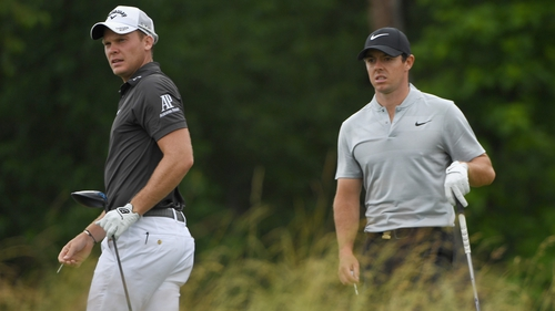 Willett and McIlroy during their first round at Oakmont, which was cut short due to thunder storms