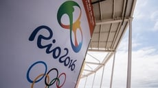 Three Russian swimmers have been banned from Rio by FINA, while four more have withdrawn