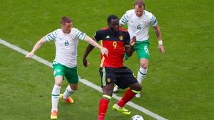 Ireland midfielders James McCarthy and Glenn Whelan pay close attention to Romelu Lukaku