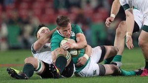 Craig Gilroy is tackled by Francois Louw in Johannesburg