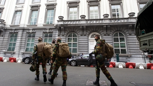Belgian soldiers are seen on the  streets of Brussels following the overnight raids