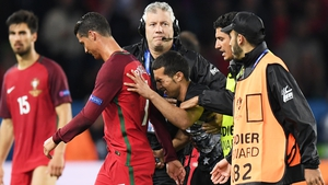 UEFA were not impressed that this fan got so close to Cristiano Ronaldo