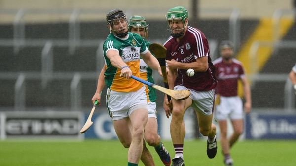 Offaly's Sean Gardiner and David Burke of Galway