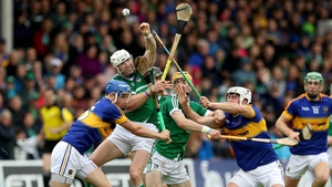 Tipperary's Patrick Maher and John McGrath battle with Seamus Hickey of Limerick