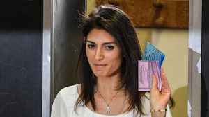 Virginia Raggi casting her ballot for mayoral run-off elections at a polling station in Rome this morning