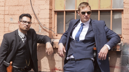 Michael Peña and Alexander Skarsgård