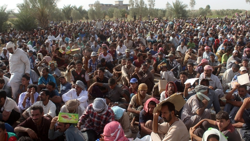 Displaced Iraqis from Fallujah rest at a safe zone after they were evacuated by Iraqi government forces