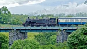 A steam train crosses a bridge in Kerry