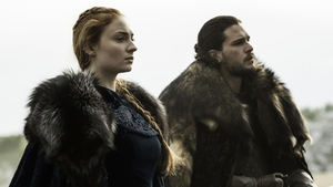 Sophie Turner and Kit Harington as Sansa Stark and Jon Snow