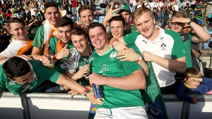 Ireland captain James Ryan celebrates with the travelling support