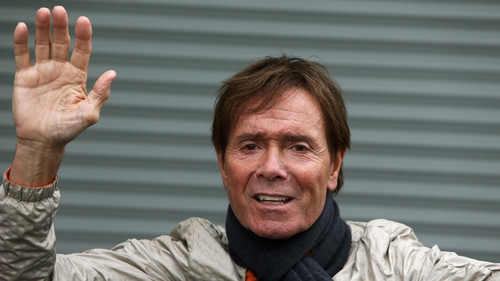 Cliff Richard waves to members of the press and fans last June