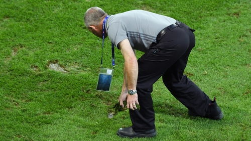 Ground staffs tend the pitch at the half time during the clash between Switzerland and France at Stade Pierre-Mauroy
