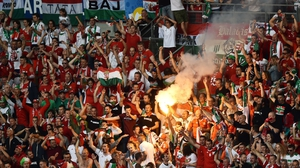 Hungary supporters threw flares onto the pitch at the end of their game against Iceland