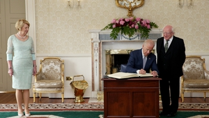 Joe Biden signs the visitors' book at the State Reception Room at Áras an Uachtaráin