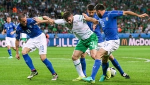 Daryl Murphy battles for possession