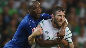 Angelo Ogbonna gets up close and personal with Daryl Murphy